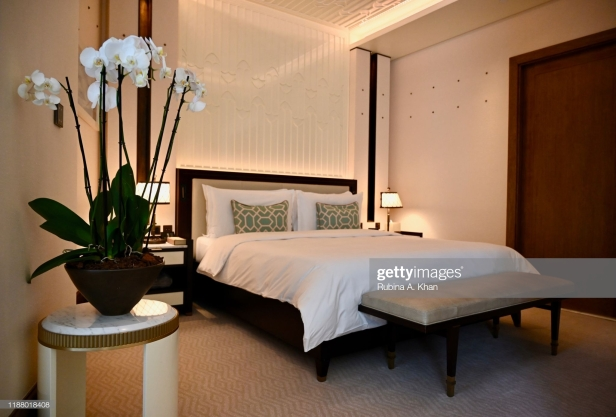 DOHA, QATAR - NOVEMBER 15: A Junior Suite bedroom with the fretwork sand dunes and metallic studs on the walls resembling the old wooden beams in Qatari homes called 'danshal' which extend horizontally from walls at the Mandarin Oriental Doha on November 15, 2019 in Doha, Qatar. (Photo by Rubina A. Khan/Getty Images)