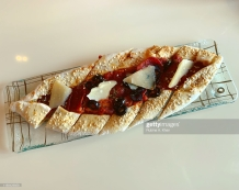 DOHA, QATAR - NOVEMBER 16: A Beef Pepperoni and Olive Turkish Pide with Oregano and Parmesan at Mosaic, the speciality nine-kitchen restaurant at the Mandarin Oriental, Doha on November 16, 2019 in Doha, Qatar. (Photo by Rubina A. Khan/Getty Images)