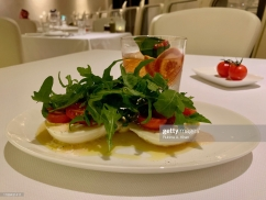 DOHA, QATAR - NOVEMBER 16: A Burrata with Cherry Tomatoes and Basil appetizer at Izu, a Mediterranean cuisine restaurant named after its Nigerian chef, Izu Ani, at the Mandarin Oriental, Doha on November 16, 2019 in Doha, Qatar. (Photo by Rubina A. Khan/Getty Images)