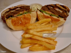 DOHA, QATAR - NOVEMBER 17: A Wagyu Burger with Veal Bacon and Fries at the outdoor terrace at Izu, a Mediterranean cuisine restaurant named after its Nigerian chef, Izu Ani, facing the Barahat Msheireb Town Square at the Mandarin Oriental, Doha on November 17, 2019 in Doha, Qatar. (Photo by Rubina A. Khan/Getty Images)