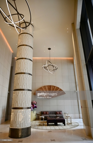 DOHA, QATAR: Fretwork sand dune columns, with a painted eggshell finish, designed by the David Collins Studio, at the main entrance lobby of the Mandarin Oriental, Doha in Qatar